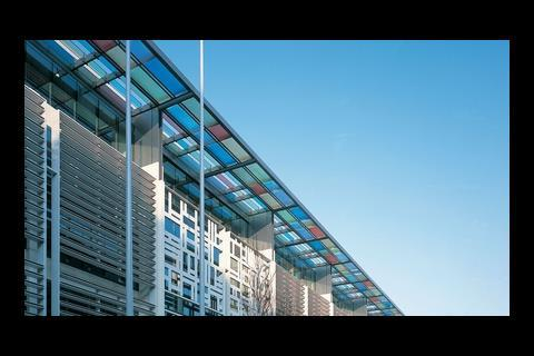 The facade of Sir Terry Farrell's Home Office building combines aluminium louvres with dark and colour-tinted glazing